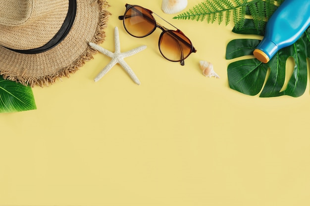 Travel accessories items on yellow background, summer vacation concept Premium Photo