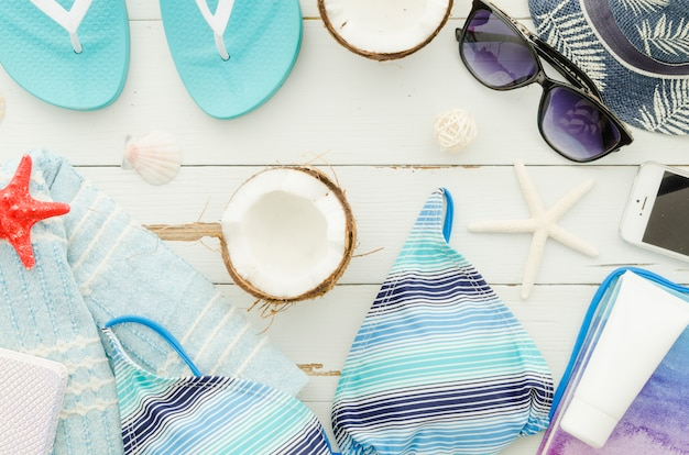 Travel accessories with coconut Free Photo