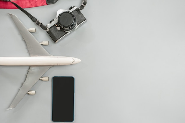 Travel accessories with vintage camera, airplane and ...