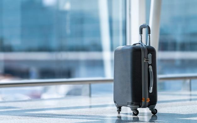 Travel bag luggage at airport terminal Premium Photo