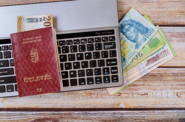 Travel citizenship hungarian passports with money banknotes of hungarian forint banknotes Premium Photo