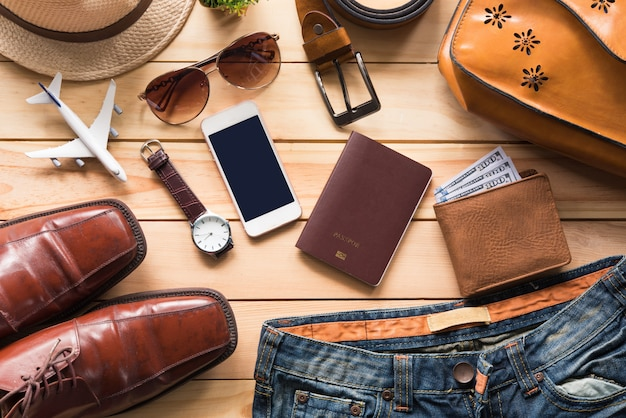 Travel clothing accessories apparel along on wooden floor Premium Photo