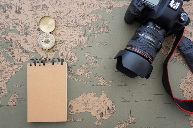 Travel composition with compass, camera and notebook Free Photo