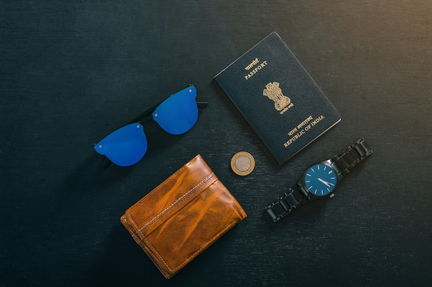 Travel concept, indian passport with watch, wallet, sunglasses Premium Photo