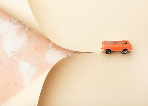 Travel concept with world map and toy van Free Photo
