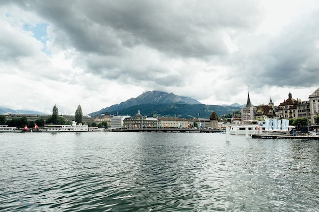 Travel in Switzerland. Beautiful view on lake in Lucerne, city and mountain. Tourism Free Photo