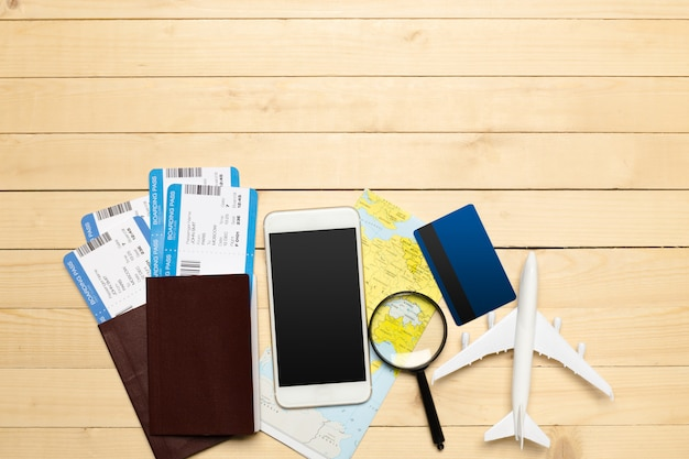 Travel objects on wooden background Premium Photo