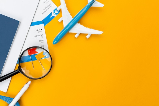 Travel planning concept elements on orange background Premium Photo
