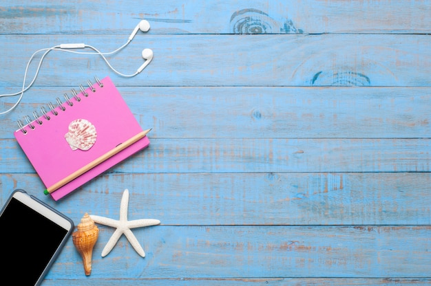 Travel,summer accessories on blue wood Free Photo