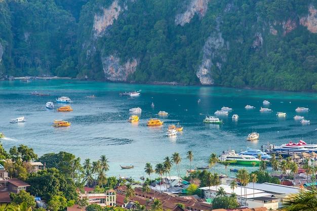 Travel vacation background tropical island with resorts phi-phi island krabi province thailand Premium Photo