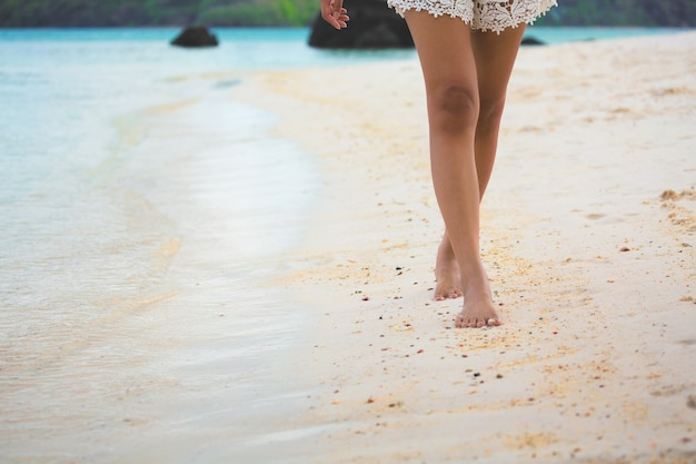 Travel woman foot on beach Premium Photo