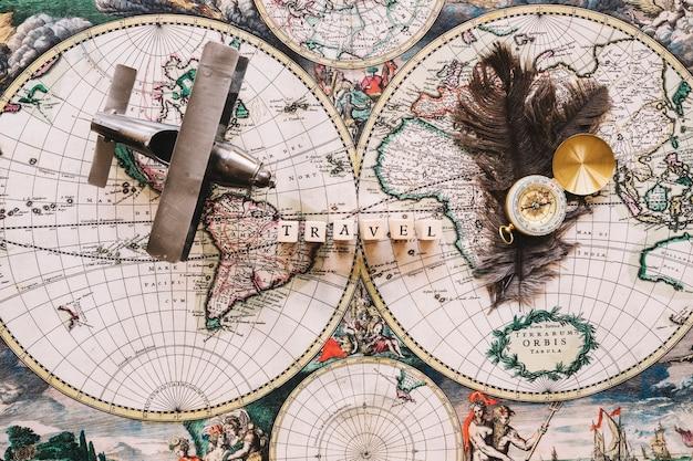 Travel writing and feathers near tourist stuff Free Photo