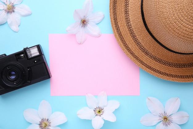 Traveler accessories on blue travel vacation concept. Premium Photo