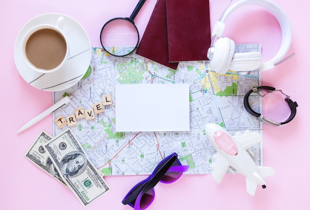 Traveler accessories and cup of tea on pink background Free Photo