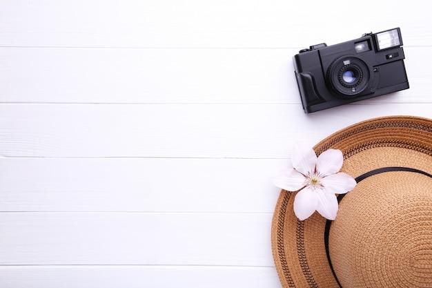 Traveler accessories on white wooden travel vacation concept. Premium Photo