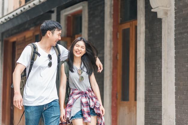 Traveler asian backpacker couple feeling happy traveling in beijing, china Free Photo