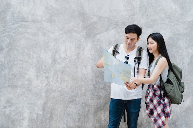 Traveler asian couple direction on location map in beijing, china Free Photo