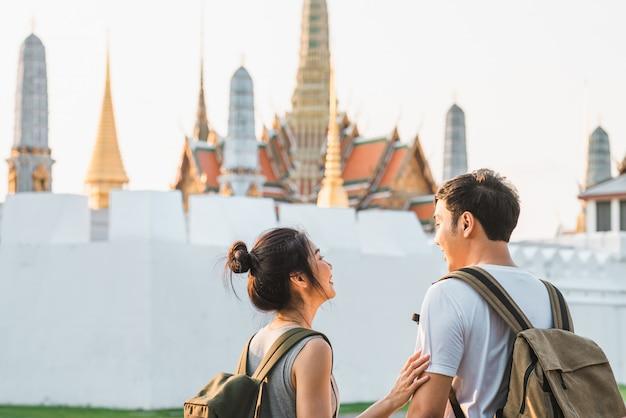 Traveler asian couple traveling and walking in bangkok, thailand Free Photo