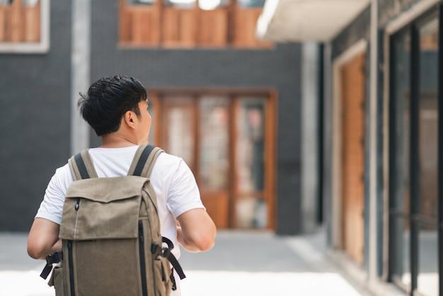 Traveler asian man traveling and walking in beijing, china Free Photo