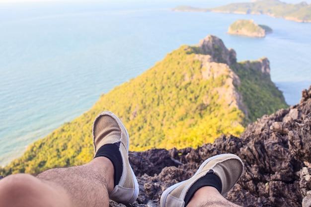 Traveler man hiking canvas shoesnear  ocean on nature Premium Photo