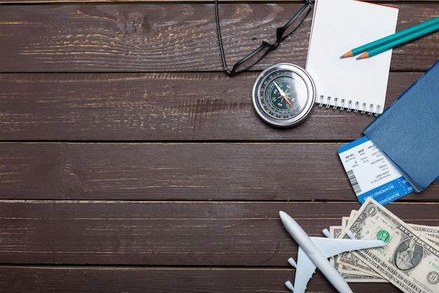 Traveler objects on wooden table Premium Photo