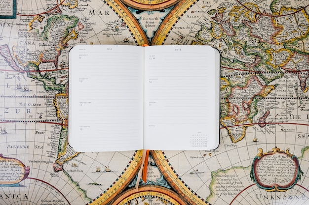 Traveler's empty diary on historical map Free Photo
