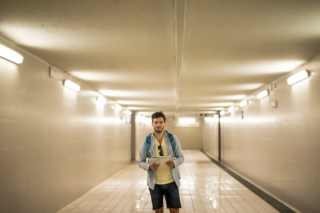 Traveler in underpass at train station Free Photo