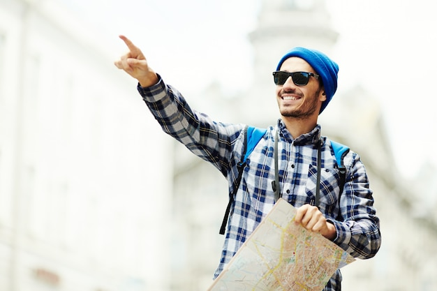 Traveler with map Free Photo