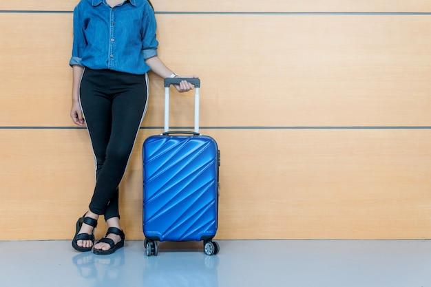 Traveler women and luggage at airport terminal travel concept Premium Photo