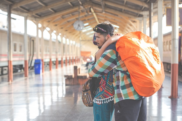 Travelers love each other while traveling. Free Photo