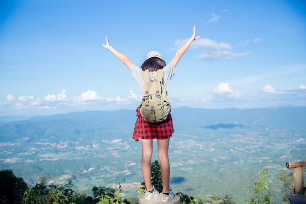 Travelers, young women, look at the amazing mountains and forests, wanderlust travel ideas, Free Photo