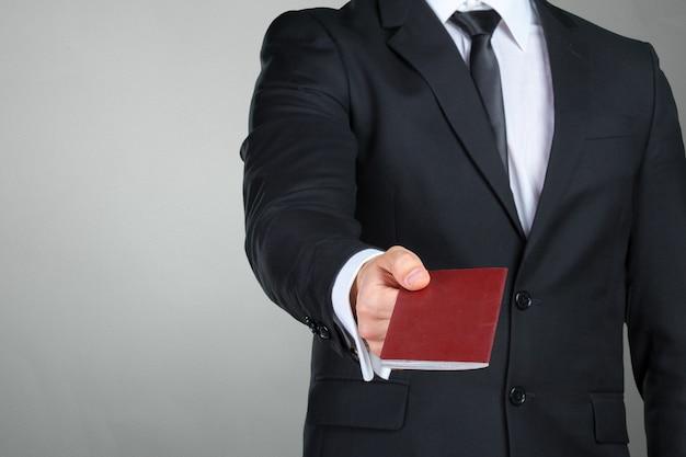 Traveling businessman handing passport Premium Photo