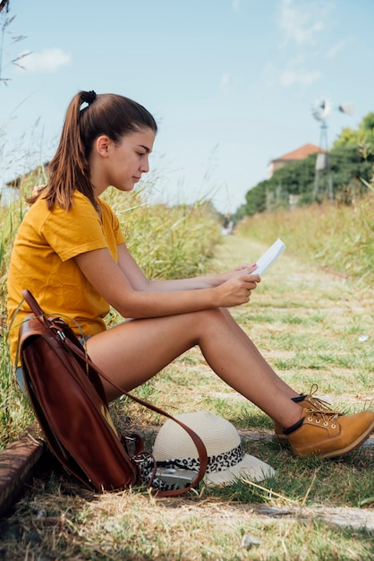 Traveling girl checking her map Free Photo