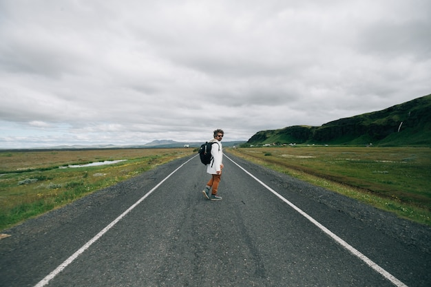 Traveller man with backpack explore iceland Free Photo