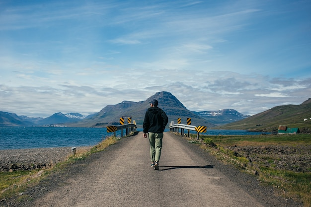 Traveller man with backpack explores iceland Free Photo