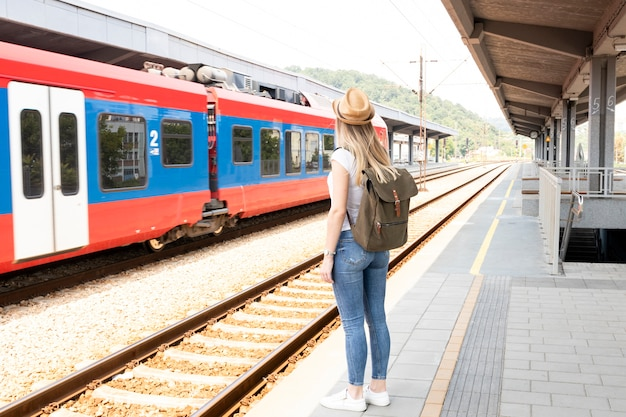Traveller woman in a train station Free Photo