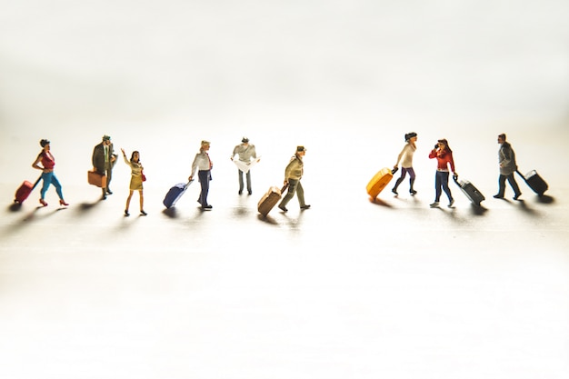 Travelling concept with group of travelers in miniature Free Photo