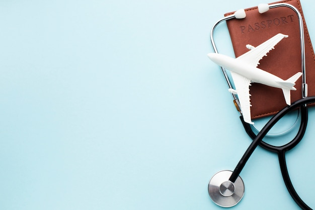 Travelling medical insurance with airplane copy space Free Photo