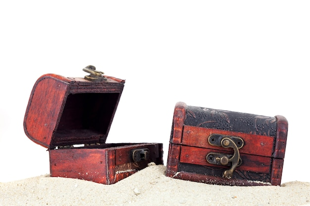 Treasure box on sand isolated white background. Premium Photo