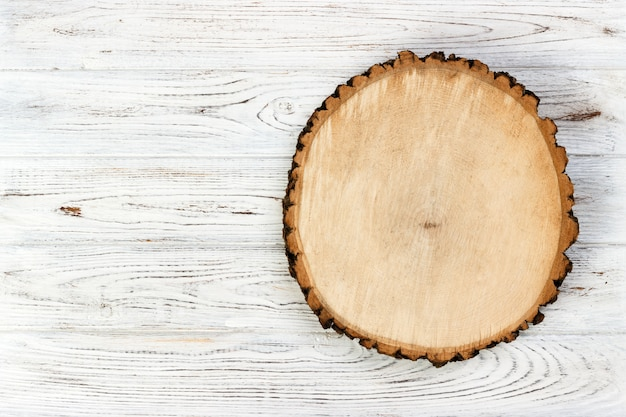 Tree stump round cut with annual rings on wooden background. top view with copy space Premium Photo