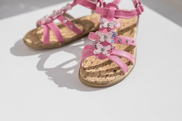 Trendy baby pink sandals.close up of baby shoes, kids summer fashion. shoes for girls, children's slippers, beach fashion for baby, Premium Photo