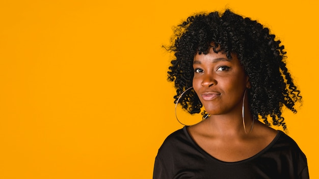 Trendy black young female on colored background Free Photo