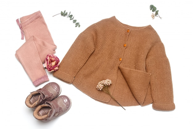 Trendy clothes for little lady on white background. fashionable pastel muted shades. Premium Photo