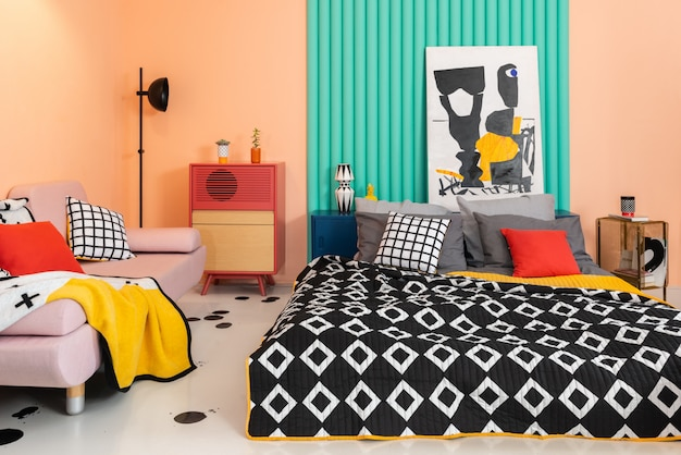 Trendy colorful bedroom with bright patterned textile. Premium Photo
