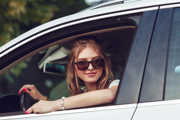 Trendy girl traveling by car Premium Photo