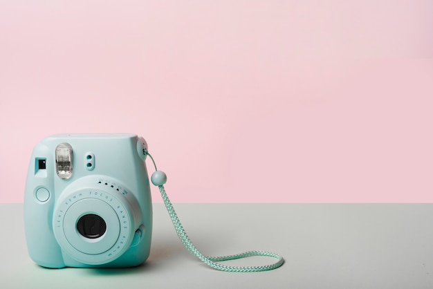 Trendy mini instant camera against pink background Free Photo