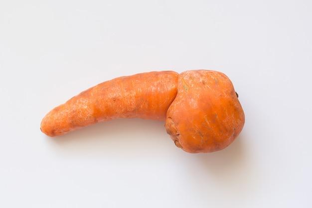 Trendy organic ugly carrot Premium Photo