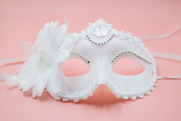 Trendy ornamental white mask for carnival Free Photo