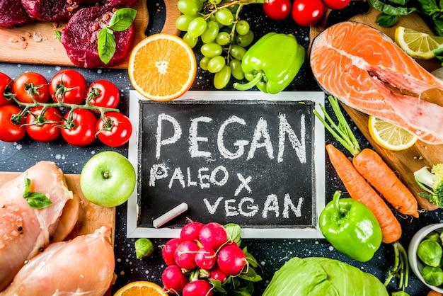 Trendy pegan diet food ingredients, meat, seaffod and vegetables Premium Photo