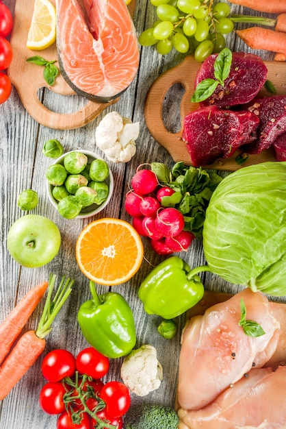 Trendy pegan diet, meat, eggs, seafood, dairy products and various fresh vegetables Premium Photo